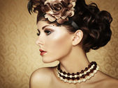 Retro portrait of a beautiful woman. Vintage style — Stock Photo