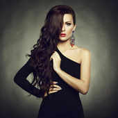 Portrait of beautiful brunette woman in black dress — Stok fotoğraf