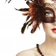 Beautiful young woman in brown mysterious venetian mask — Stock Photo
