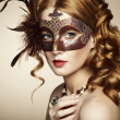 Beautiful young woman in brown mysterious venetian mask — Stock Photo #15637981
