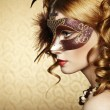 Beautiful young woman in brown mysterious venetian mask — Stock Photo #15637987