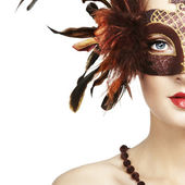 Beautiful young woman in brown mysterious venetian mask — Foto Stock