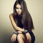 Portrait of beautiful brunette woman in black dress — Стоковое фото