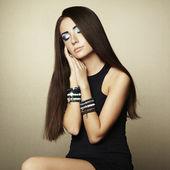 Portrait of beautiful brunette woman in black dress — Stock Photo