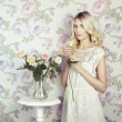Portrait of a beautiful blonde woman with flowers — Stock Photo #18998965