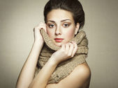 Portrait of a beautiful young woman with scarf — Stockfoto