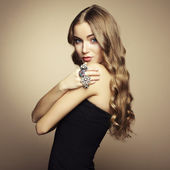 Portrait of beautiful blonde woman in black dress — Stok fotoğraf