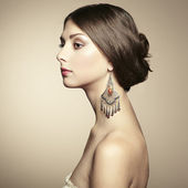 Portrait of beautiful young woman with earring — Stock Photo
