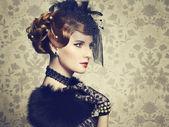 Retro portrait of beautiful woman. Vintage style — Stock Photo