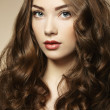 Portrait young beautiful woman with curly hair — Stock Photo