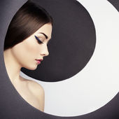 Conceptual fashion portrait of a beautiful young woman — Stock Photo