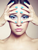 Beautiful young woman with bright make-up and manicure — Stock Photo