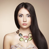 Portrait of young beautiful woman with jewelry — Stock Photo