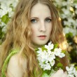 Beautiful young woman in summer garden — Foto Stock