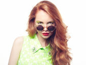 Portrait of beautiful woman in sunglasses on white background — Stock Photo