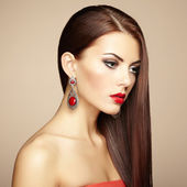 Portrait of beautiful brunette woman with earring. Perfect makeu — Stock Photo