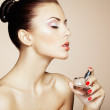Young beautiful woman with bottle of perfume. Perfect Makeup — Stock Photo