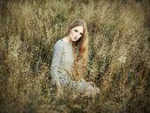 Portrait of beautiful woman on autumn field — Stock Photo