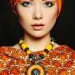Portrait young beautiful woman with necklace — Stock Photo