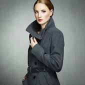 Portrait of young woman in autumn coat — Stock Photo