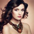Stock Photo: Portrait of beautiful brunette woman with earring. Perfect makeu