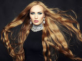 Photo of beautiful woman with magnificent hair. Perfect makeup — Stock Photo