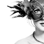 The beautiful young woman in mysterious venetian mask — Stock Photo