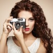 Portrait of beautiful woman with the camera. Girl photographer — Stock Photo