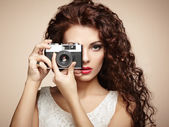 Portrait of beautiful woman with the camera. Girl photographer — Foto de Stock