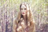 Beautiful young woman in summer garden — Stock Photo