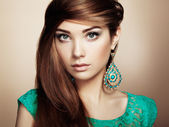 Portrait of beautiful young woman with earring. Jewelry and acce — Stock Photo