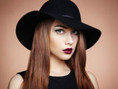 Fashion photo of young magnificent woman in hat. Girl posing — Stock Photo