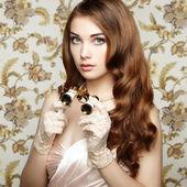 Portrait of young woman with binoculars. Fashion portrait — Стоковое фото