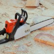Stock Photo: Chainsaw is on background wooden shavings