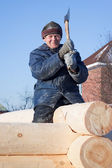 Man builds a wooden house — Stock Photo