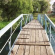 Stock Photo: Bridge over river in provincial town