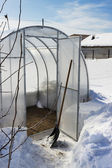 A small greenhouse in winter — Stock Photo