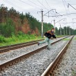 Elderly man crosses a railway embankment - Stock Photo