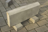 One large curb stone is made of concrete — Stock Photo