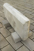 Large curb stone is made of concrete — Stock Photo