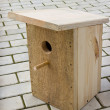 Small birdhouse from boards — Stock Photo #43775797