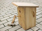 Small birdhouse from boards — Stock Photo