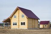 Новый бревенчатый дом и vaporarium — Стоковое фото