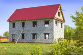House from foam concrete blocks in the meadow — Stock Photo