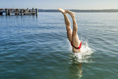 Jumping into the water — Stock Photo