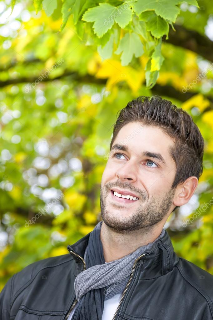 An image of a handsome young man in the autumn  Stock Photo #13410996