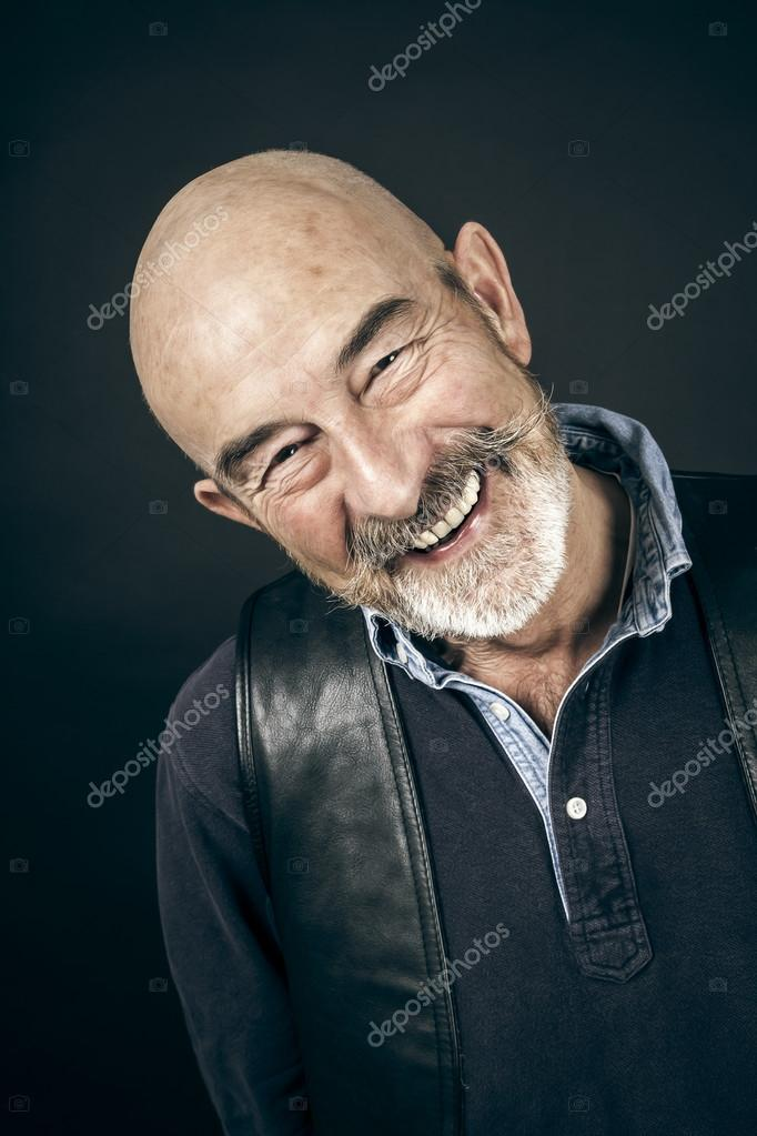 An old man with a grey beard  Stock Photo #14370845