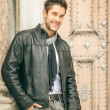 Stock Photo: Young man black leather