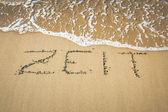 Slovo v písku — Stock fotografie