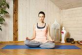 Yoga woman siddhasana — Stock Photo